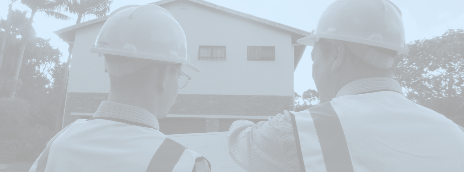 heeger engineers are Structural Engineers based in Durban. men looking at plans on construction site.